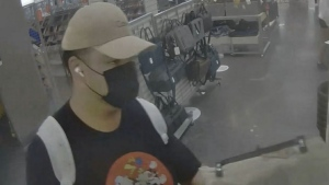 A man accused of spying on a woman while she changed is shown in a surveillance camera image. (YRP)