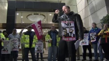 CUPE vice-president Paul Farrow speaks to hundreds of striking ambulance workers at a Vancouver rally on Nov. 23, 2009.