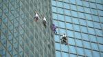 French men seen climbing skyscraper