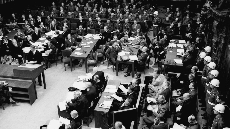FILE - In this Nov. 20, 1945 file photo, military police line the courtroom during the first morning session in Nuremberg. (AP Photo/B.I. Sanders, file)