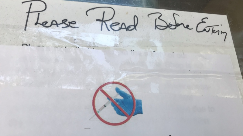 Vaccine-related sign on the front window of a store in Windsor, Ont. on Tuesday, Sept. 7, 2021. (Michelle Maluske / CTV Windsor)