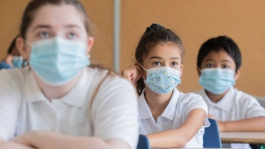 Students wear face masks as they attend class on the first day of school in Montreal, Tuesday, August 31, 2021, as the COVID-19 pandemic continues in Canada and around the world. THE CANADIAN PRESS/Graham Hughes
