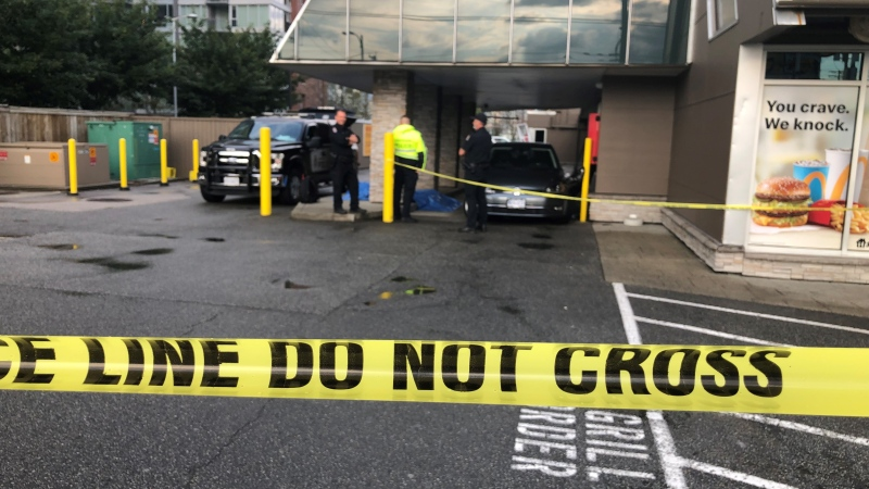 Police tape blocks a McDonald's drive-thru in Vancouver on Wednesday, Sept. 8, 2021.