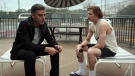 """This image released by Focus Features shows Oscar Isaac, left, and Tye Sheridan in a scene from """"The Card Counter."""" (Focus Features via AP)"""