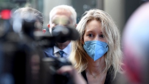 Elizabeth Holmes, founder and CEO of Theranos, arrives at the federal courthouse for jury selection in her trial, Tuesday, Aug. 31, 2021, in San Jose, Calif. (AP Photo/Nic Coury)