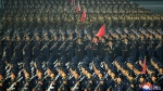 In this photo provided by the North Korean government, North Korean troops parade during a celebration of the nation's 73rd anniversary that was overseen by leader Kim Jong Un, at Kim Il Sung Square in Pyongyang, North Korea, early Thursday, Sept. 9, 2021. (Korean Central News Agency/Korea News Service via AP)