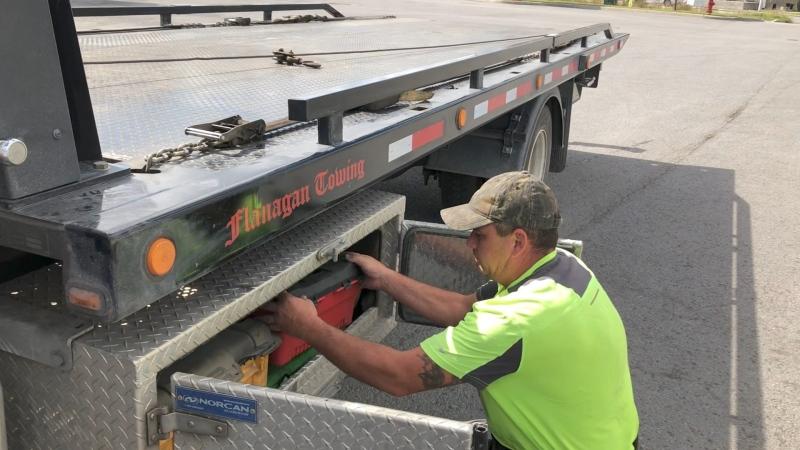Jason Laverty checking the equipment on his tow truck. (Dave Charbonneau/CTV News Ottawa)