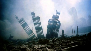 The remains of the World Trade Center stand amid the debris in New York, Tuesday, Sept. 11, 2001. (AP Photo/Alexandre Fuchs)