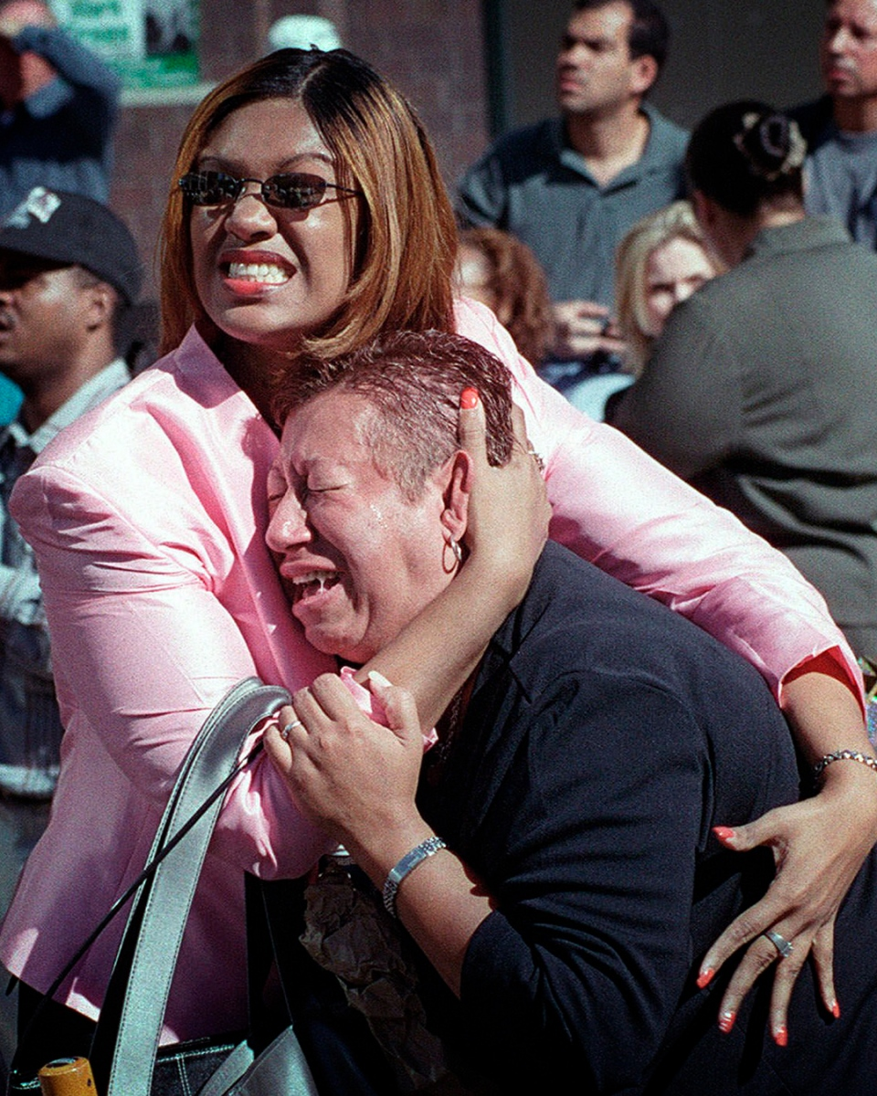 Two women hold each other at World Trade Center
