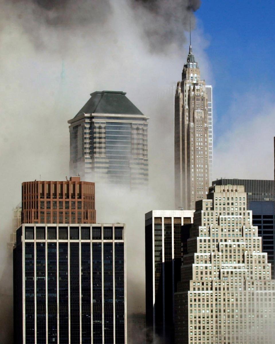 Smoke billows through buildings in Manhattan
