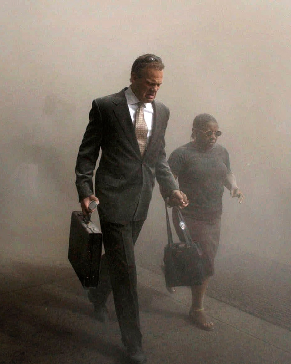 Pedestrians flee from the World Trade Center site
