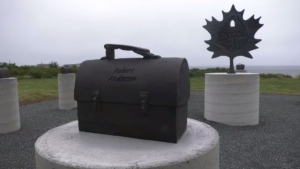 A sexually explicit image that has been spray painted at the base of the main statue has put a damper on commemorations. The tribute is only days old.