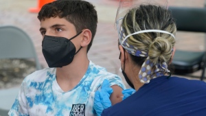 Andres Veloso, 12, gets the first dose of the Pzifer COVID-19 vaccine, Monday, Aug. 9, 2021, in Miami. (AP Photo/Marta Lavandier)