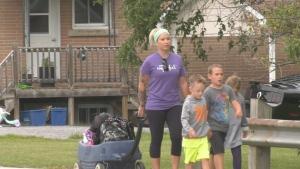 Chelsea-Ann Washburn walking her children home from school in Arnprior. (Dylan Dyson/CTV News Ottawa)