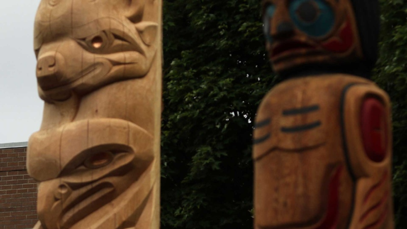 Staff look on as one Reconciliation Pole and two Welcome Figures were unveiled during a ceremony in honour of truth and reconciliation on National Peoples Indigenous Day at the Vancouver School District in Vancouver, B.C., on Friday, June 21, 2019. THE CANADIAN PRESS/Chad Hipolito
