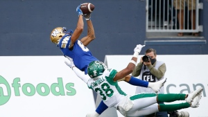 Winnipeg Blue Bombers' Kenny Lawler (89) catches the touchdown pass against Saskatchewan Roughriders' Christian Campbell (38) during the second half of CFL action in Winnipeg Saturday, September 11, 2021. THE CANADIAN PRESS/John Woods