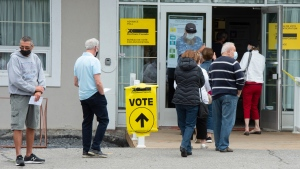 People line up to vote in the advance polls for the federal election, Friday, September 10, 2021 in Chambly, Que. (THE CANADIAN PRESS / Ryan Remiorz)