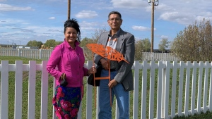 Sarah Longman and Pasqua First Nation Chief Matthew Peigan with one of the markers at the RIIS Heritage Site (Kaylyn Whibbs/CTV News)