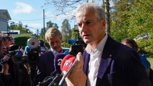 Norway's Labour Party leader Jonas Gahr Store answers questions from reporters outside his home in Oslo, on Sept. 14, 2021. (Terje Bendiksby / NTB via AP)