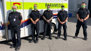 An Ottawa paramedic crew of three members (middle), including one who was on his very first shift, helped deliver a healthy baby girl at an Ottawa home Tuesday morning. Left to right: Commander Joe Micucci; PCP Mehran Massom; ACP Simon Blanchard; PCP Mike Vareta; Acting Commander Reid Purdy. (Photo submitted by the Ottawa Paramedic Service)