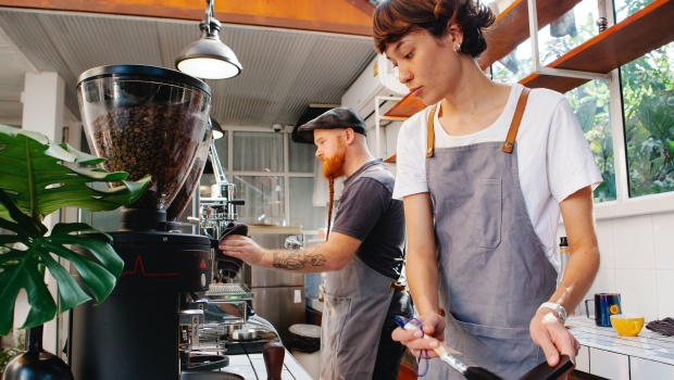Baristas can be seen making coffee in this stock photo. (Tim Douglas/Pexels)
