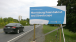 The roundabout sign on County Road 2. (Nate Vandermeer / CTV News Ottawa)
