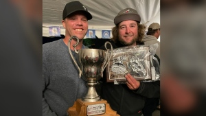 Steve Taylor (left) and Cody Strass (right) pose after the awards at a fishing tournament on Sept. 11, 2021. (Kolby Matiachuk/Submitted)