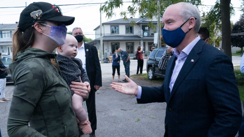 Conservative leader Erin O'Toole speaks with a mother and daughter during a campaign stop on Tuesday, September 14, 2021 in Russell, Ontario. THE CANADIAN PRESS/Adrian Wyld