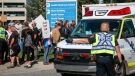Protesters gather at the Foothills Hospital to oppose COVID-19 related public health measures in Calgary, Alta., Monday, Sept. 13, 2021. THE CANADIAN PRESS/Jeff McIntosh