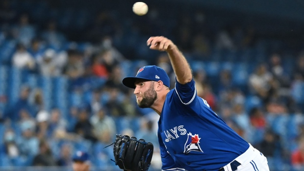 Toronto Blue Jays' Tim Mayza pitches in the eighth inning of an American League baseball game against the Tampa Bay Rays in Toronto on Tuesday, Sept. 14, 2021. THE CANADIAN PRESS/Jon Blacker