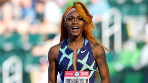 In this June 19, 2021 photo, Sha'Carri Richardson celebrates after winning the first heat of the semis finals in women's 100-meter runat the U.S. Olympic Track and Field Trials in Eugene, Ore. (AP Photo/Ashley Landis)