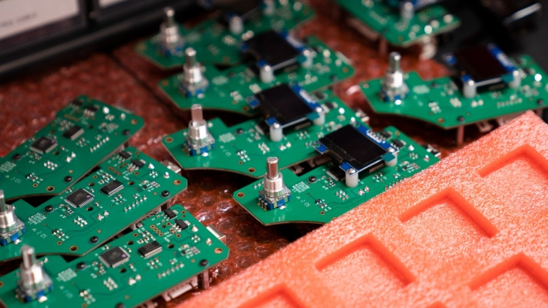 Semi-conductor chips are assembled and organized on a workbench at the Nanotronics manufacturing centre at the Brooklyn Navy Yard, on April 28, 2021. (John Minchillo / AP)