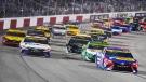 Denny Hamlin (11) and Martin Truex Jr., (19) lead the field at the start of the NASCAR Cup series auto race in Richmond, Va., on Sept. 11, 2021. (Steve Helber / AP)