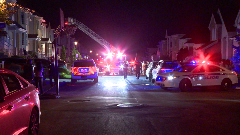Laval police are investigating after two young men were shot and a fire was started on a residential street. (Cosmo Santamaria/CTV News Montreal)