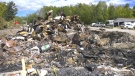 Efforts are being made to clean up after the Moosehead Inn burned to the ground on Saturday. (Luke Simard/CTV News)