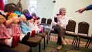 Judy Wolfe gets some advice while deciding which Cabbage Patch Kids to adopt at a collector's convention at Babyland General Hospital, the birthplace of Cabbage Patch Kids, in Cleveland, Ga., on Nov. 21, 2014. (David Goldman / AP)