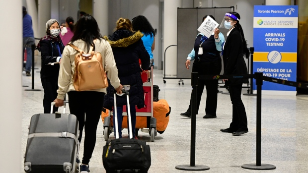 Travellers arrive at Terminal 3 at Pearson Airport in Toronto early Monday, February 22, 2021. THE CANADIAN PRESS/Frank Gunn