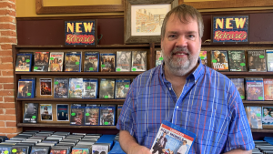 Classic Video owner Tom Ivison holds a copy of a movie that was returned nine years late. (Kimberley Johnson / CTV News Ottawa)