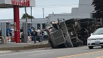 A truck on its side after a single vehicle crash at the intersection of Bank Street and Leitrim Road. (Photo courtesy: CTV News Ottawa viewer Stephen Doyle)