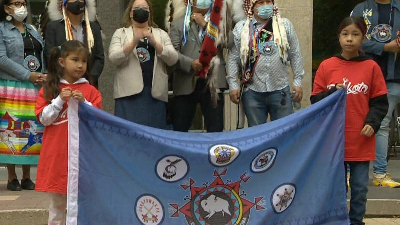 City Hall flag raising marks reconciliation effort