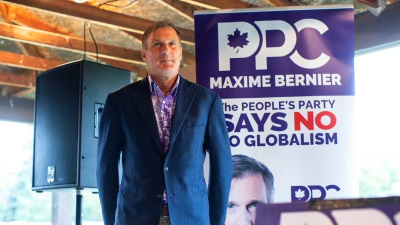 Peoples Party of Canada leader Maxime Bernier waits to speak during a rally held in Vegreville Alta., on Sunday September 12, 2021. THE CANADIAN PRESS/Jason Franson