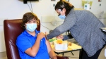 Joel McLaughlin, 17, gets a COVID-19 vaccine shot in this supplied photo.