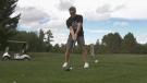 Jason Blaine tees off at the Jason Blaine Celebrity Charity Golf Classic in Pembroke, Ont. (Dylan Dyson/CTV News Ottawa)