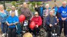Will Dwyer, 96, (centered in a red jacket) poses with his fellow Chartwell Whispering Pines residents after completing the Terry Fox Run/Walk in Barrie, Ont., on Wed., Sept. 15, 2021 (KC Colby/CTV News)
