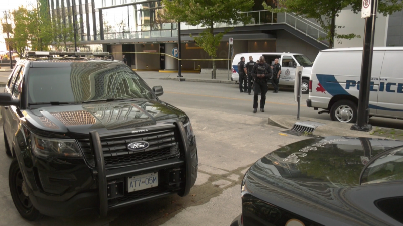 Police investigate a shooting in the waterfront area of downtown Vancouver on Wednesday, Sept. 15, 2021.