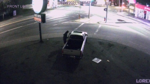 An image from security footage taken by Budget Brake and Muffler on Douglas Street in Victoria allegedly shows a man breaking into a pick-up truck and stealing it: (Budget Brake and Muffler)