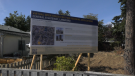 A rezoning application sign for the Langford Gateway and Langford Central projects on Peatt Road as seen on Sept. 15, 2021. (CTV News)