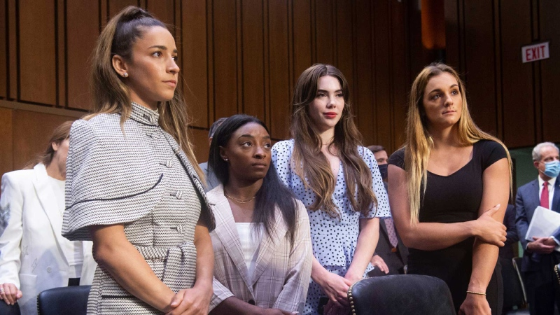United States gymnasts from left, Aly Raisman, Simone Biles, McKayla Maroney and Maggie Nichols, leave after testifying at a Senate Judiciary hearing about the Inspector General's report on the FBI's handling of the Larry Nassar investigation on Capitol Hill, Wednesday, Sept. 15, 2021, in Washington. (Saul Loeb/Pool via AP)