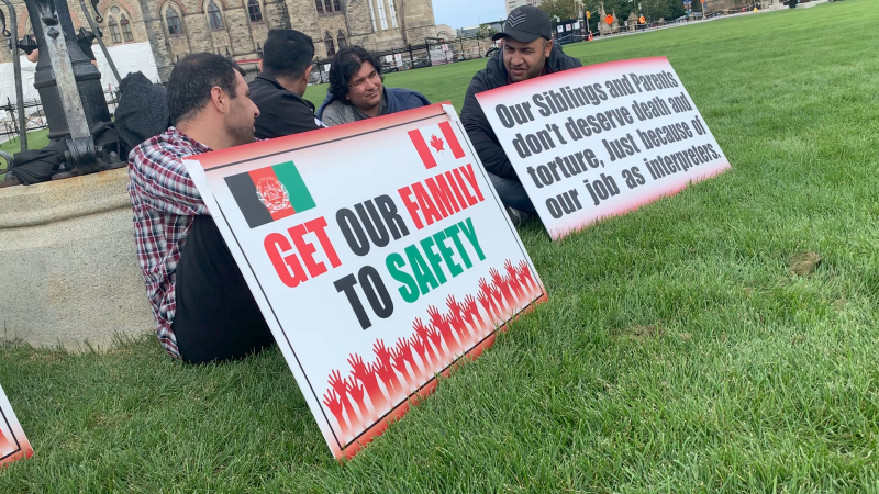 Former Afghan interpreters on Parliament Hill Wednesday called for their relatives to be resettled in Canada. (Jackie Perez/CTV News Ottawa)