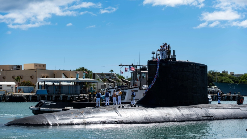 In this photo provided by U.S. Navy, the Virginia-class fast-attack submarine USS Illinois (SSN 786) returns home to Joint Base Pearl Harbor-Hickam from a deployment in the 7th Fleet area of responsibility on Sept. 13, 2021. (Michael B. Zingaro/U.S. Navy via AP)
